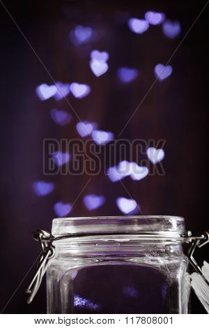 Love magic bottle on blurred background