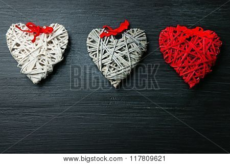 Beautiful romantic hearts on wooden background