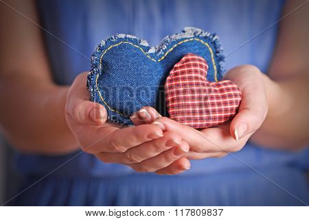 Closeup of craft hearts in female hands