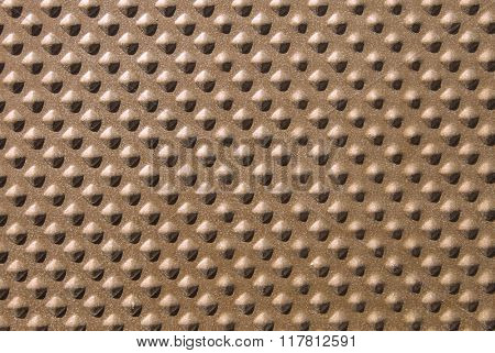 Abstract gold textured background with a decorative pattern.