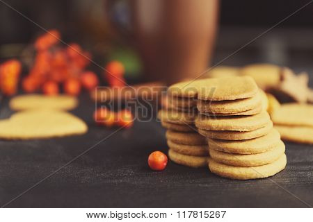 Heart shaped biscuits with marshmallow and sweet spaces on a table