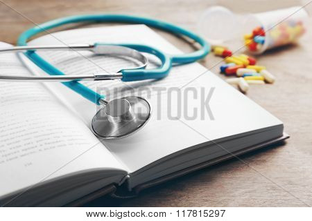 Stethoscope on a book, close up