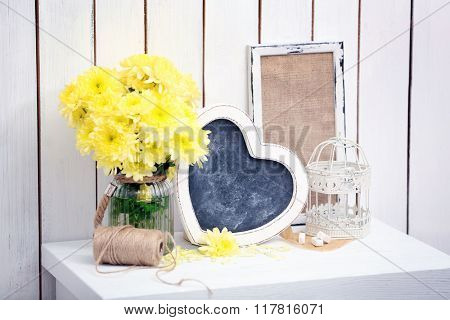 Wooden decor with flowers for mother's day on wall background
