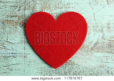 Red felt hearts on blue wooden background