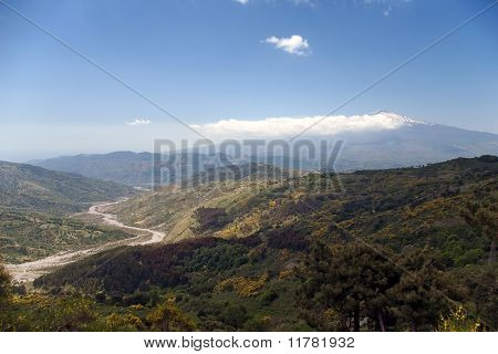 Beautiful Valley Of The Sicilian Hinterland Under The Majestic Volcano Etna With Dry River Bed