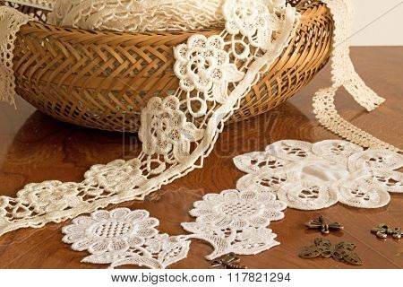 lace tape in a wicker basket on the table.