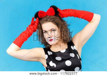 Attractive Girl In Likeness Of Cat On Blue Background Posing