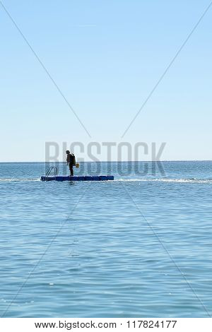 Skin-diver On Float Board