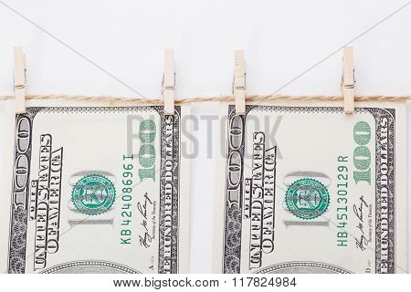 Money Laundering And Dry After Wash Hang On Clothespins Isolated On White