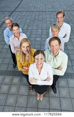 Business people standing in a dynamic team formation