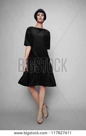 Brunette woman in black dress