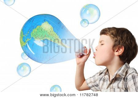 Little Caucasian Boy Blowing Soap Bubbles On White Background, Side View