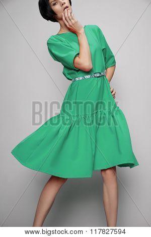 Brunette woman in green dress