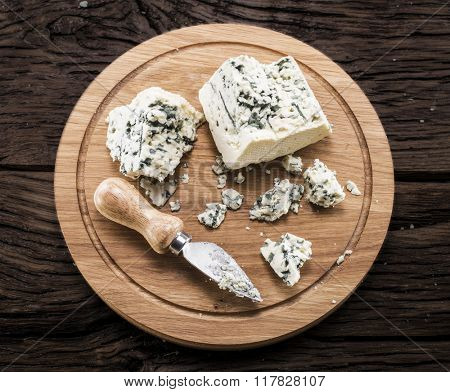 Danish blue cheese on a wooden board.