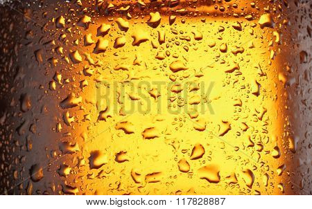 Water drops on glass of beer. Close up.