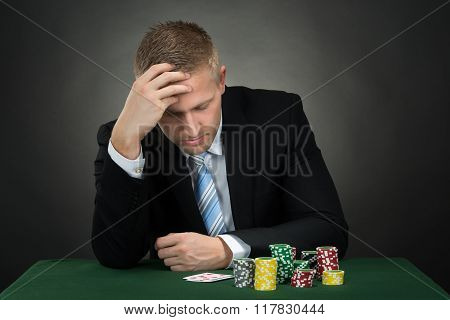 Portrait Of A Depressed Young Male Poker Player