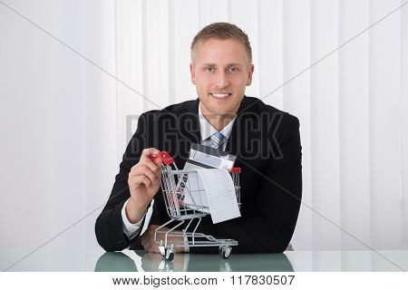 Man Holding Shopping Trolley
