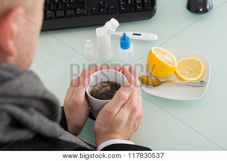 Businessman Holding Cup Of Tea At Office