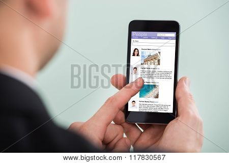 Man Surfing On Social Networking Site