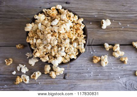Salt Popcorn On The Wooden Table, Selective Focus, Top View