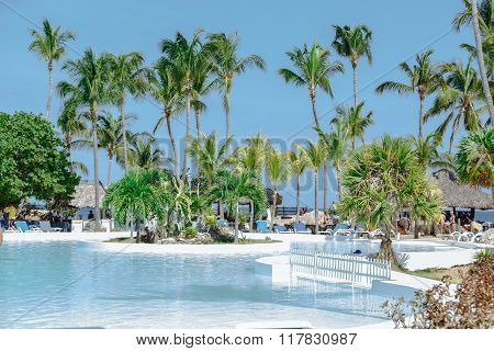 gorgeous splendid inviting view of beautiful swimming pool in tropical garden near the beach and oc
