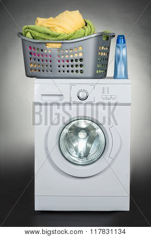 Washing Machine With Basket Against Gray Background
