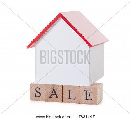 Closeup Of House Model On Sale Blocks