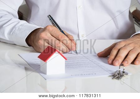 Businessman Signing House Contract