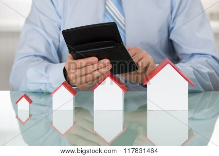 Businessman Doing Calculation On Calculator