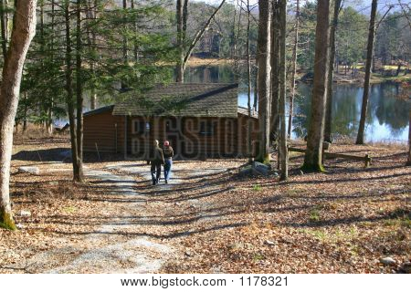 Couple At Lakeside Cabin