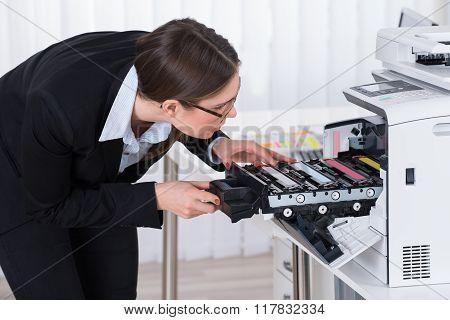 Businesswoman Fixing Copy Machine