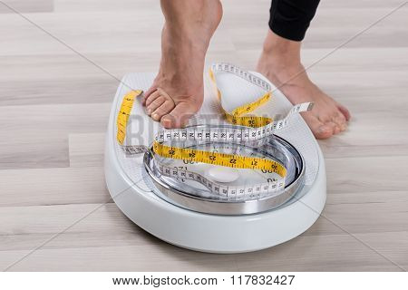 Person Feet Standing On Weighing Scale