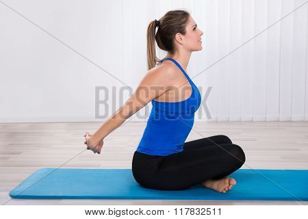 Young Female Doing Yoga At Home