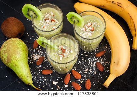 Refreshing Green Smoothie With Oat Bran And Almonds On A Black B