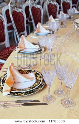 Goblets, Knives And Plates With Placemat At The Dinner table