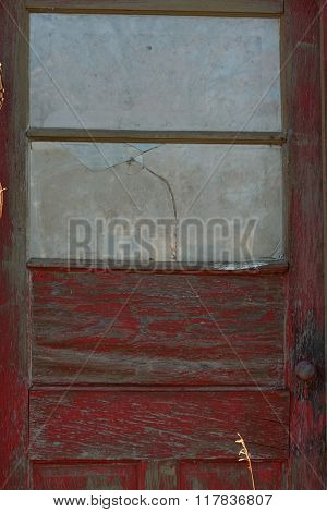 Old Red Door on Abandoned Building