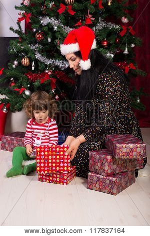 Mom And Toddler Son Opening Christmas Gifts