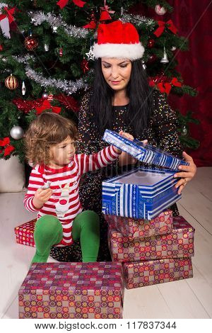 Mother And Son Opening Christmas Presents