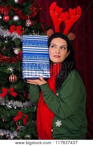 Woman Listening To Christmas Tree
