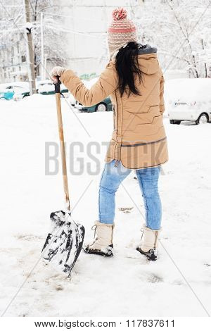 Back Of Woman Take A Break From Shoveling