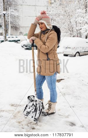 Working Woman  With Shovel  Remove Snow