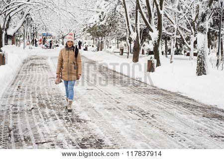 Woman Walking In  Park With Snow