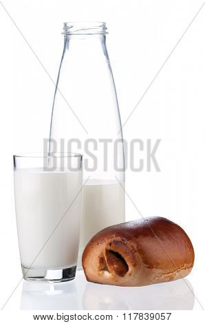 Bottle of milk and bun with poppy seeds, isolated on white background