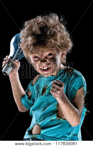 Portrait of funny little electrician with lightbulb over black background