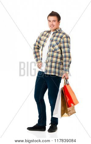 Full length portrait of a young man with shopping bags, isolated on white background