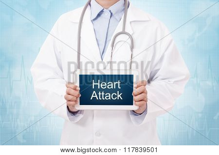 Doctor holding a tablet pc with heart attack sign on blue background