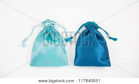 The turquoise blue and deep blue silk mini gift pouch bags