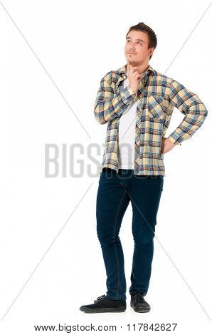 Full length portrait of young man looking thoughtful while holding his head, isolated on white background