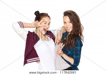 people, friends, teens and friendship concept - happy smiling pretty teenage girls showing peace hand sign