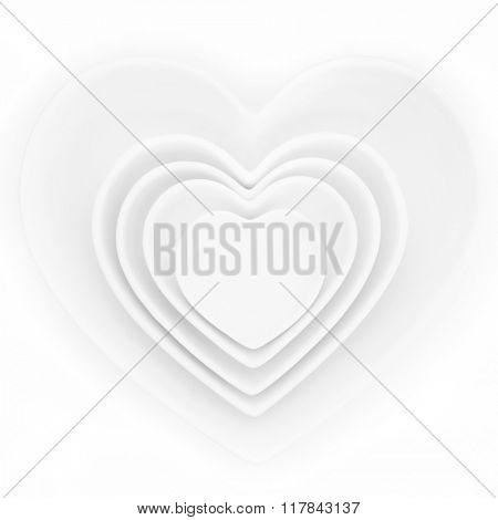 Heart shaped porcelain dishes of varying sizes over white background.